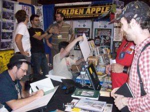 Darick Robertson signing Rob's copy of Transmetropolitan Volume 1